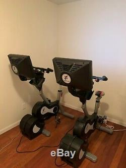 Two (2) Expresso S3U Interactive Upright Indoor Exercise Bikes (Cycling)